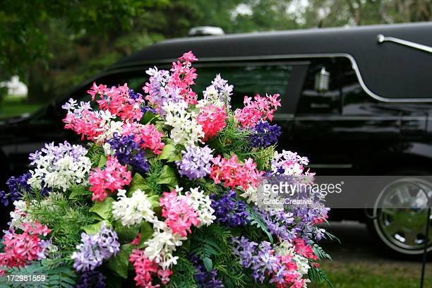 Lesson in Contrasts - Vibrant flowers and Funeral Hearse