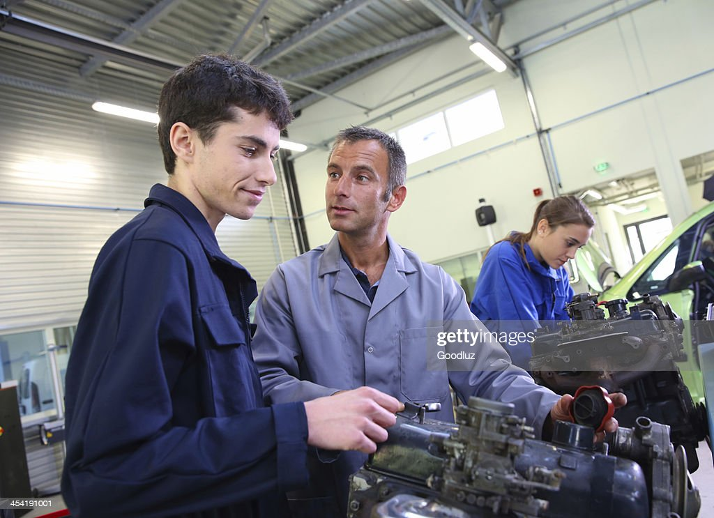 Lesson of mechanics in garage : Stock Photo