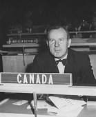 Lester B Pearson Canadian Minister and newly elected President of the United Nations General Assembly listening to the opening meeting from his seat...