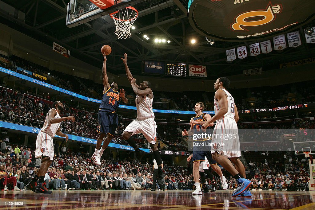 Lester Hudson #14 of the Cleveland Cavaliers goes up for the shot against <a gi-track='captionPersonalityLinkClicked' href=/galleries/search?phrase=D.J.+White+-+Basketball+Player&family=editorial&specificpeople=2537103 ng-click='$event.stopPropagation()'>D.J. White</a> #8 and <a gi-track='captionPersonalityLinkClicked' href=/galleries/search?phrase=Bismack+Biyombo&family=editorial&specificpeople=7640443 ng-click='$event.stopPropagation()'>Bismack Biyombo</a> #0 of the Charlotte Bobcats at The Quicken Loans Arena on April 10, 2012 in Cleveland, Ohio.
