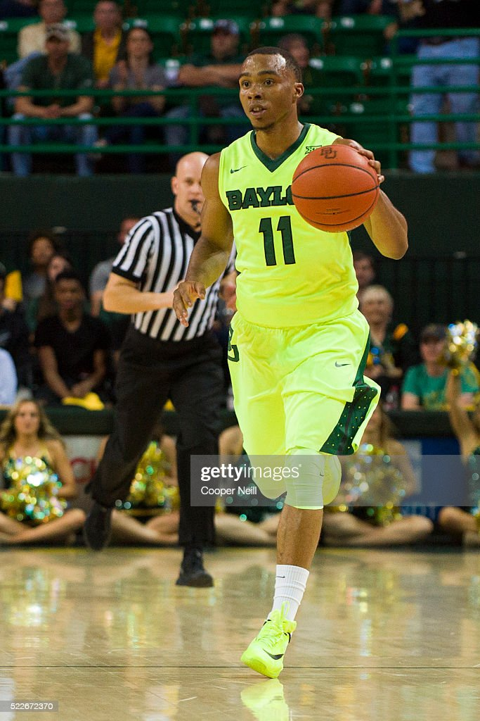 Lester Medford of the Baylor Bears brings the ball up court against the West Virginia Mountaineers on March 5 2016 at the Ferrell Center in Waco Texas