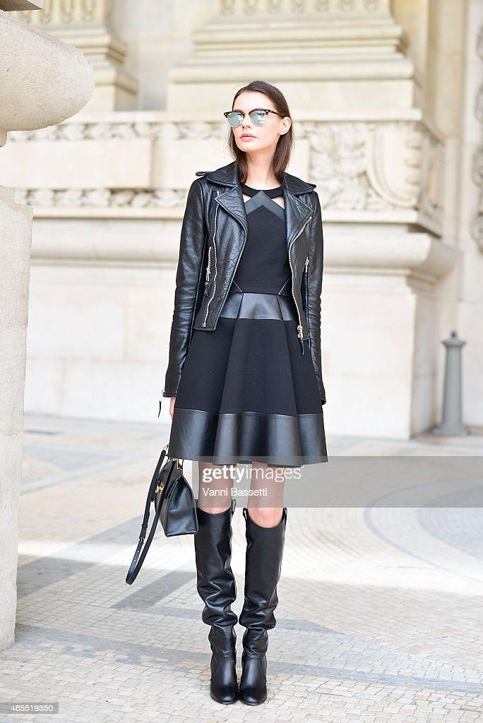 Lesya Akirtava poses wearing Balenciaga jacket and bag David Koma dress and Laurence Dacade boots on Day 5 of Paris Fashion Week Womenswear FW15 on...