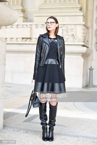 Lesya Akirtava poses wearing Balenciaga jacket and bag David Koma dress and Laurence Dacade boots on Day 5 of Paris Fashion Week Womenswear FW15 on...