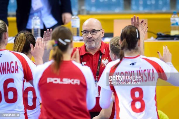 Leszek Krowicki head coach of Poland celebrates with Polish players after IHF Women's Handball World Championship group B match between Argentina and...