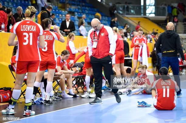 Leszek Krowicki head coach of Poland looks dejected after losing IHF Women's Handball World Championship group B match between Poland and Hungary on...