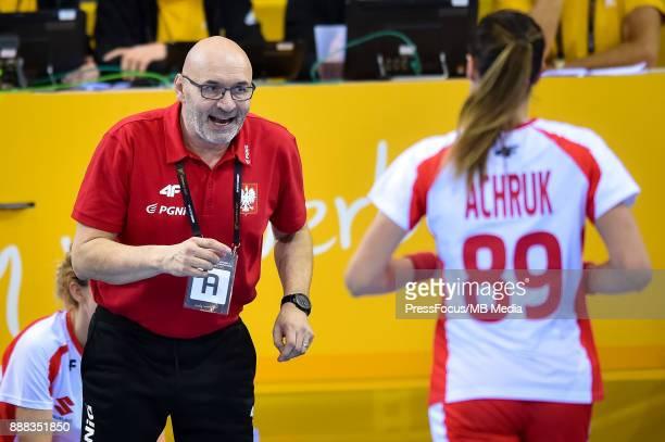 Leszek Krowicki head coach of Poland talks with Kinga Achruk of Poland during IHF Women's Handball World Championship group B match between Argentina...