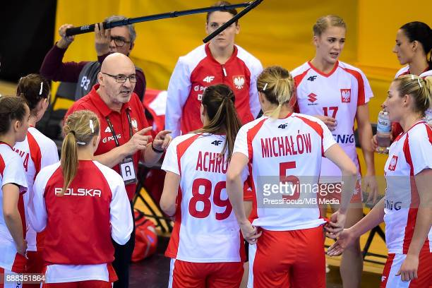 Leszek Krowicki head coach of Poland talks with Polish players during IHF Women's Handball World Championship group B match between Argentina and...