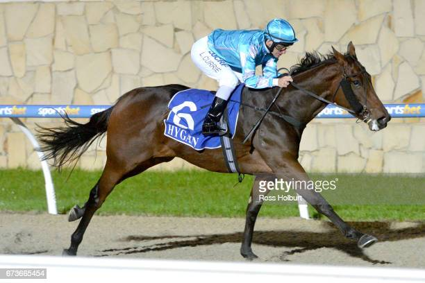 Let 'em Howl ridden by Luke Currie wins the XXXX Gold FM Maiden Plate at Racingcom Park Synthetic Racecourse on April 27 2017 in Pakenham Australia