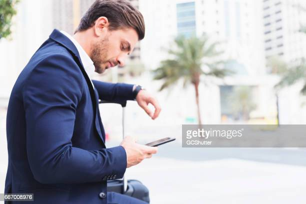 Let me check the flight status while I wait for my cab