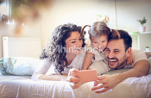 Let take a photo of our happy family. : Stock Photo