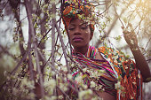 Let your beauty flourish. African American woman in the park.
