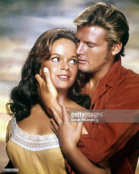 Letícia Román and Roger Moore in a promotional portrait for 'Gold Of The Seven Saints' directed by Gordon Douglas 1961