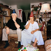 Lethargic couple in party hats