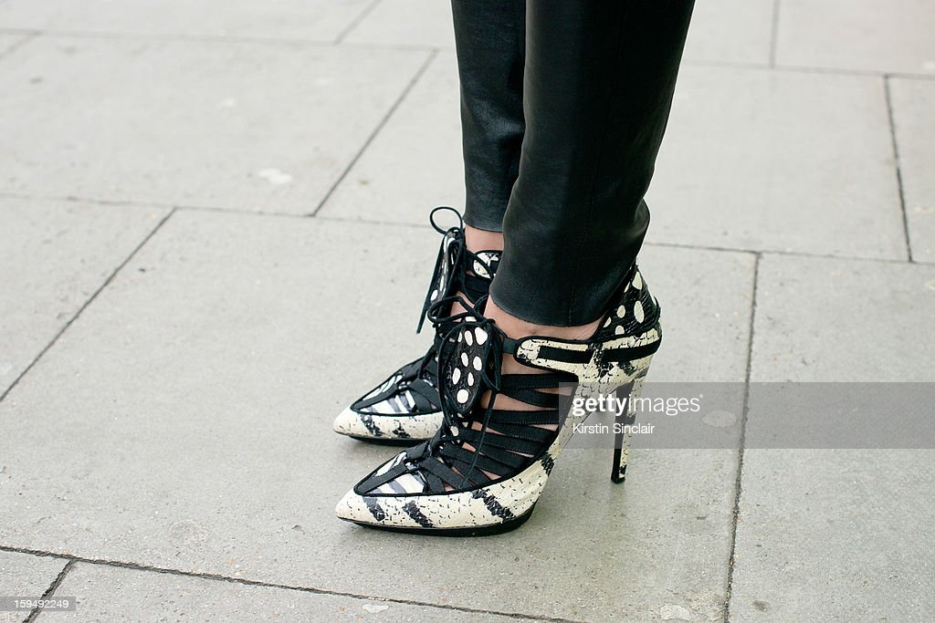 Letitia Paul; Fashion Director at French GQ wearing Pierre Hardy shoes,and Cos trousers on day 1 of London Mens Fashion Week Autumn/Winter 2013, on January 07, 2013 in London, England.