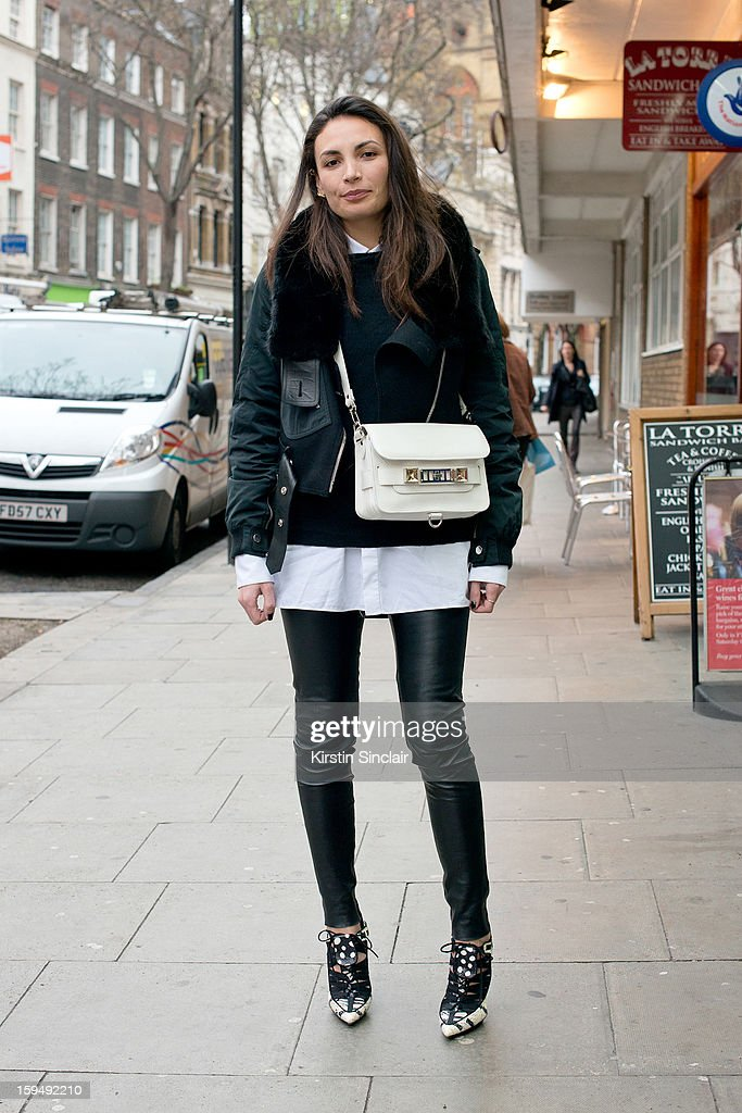 Letitia Paul; Fashion Director at French GQ wearing Pierre Hardy shoes, Proenza Shouler bag, Alexander Wang jacket,Cos trousers, Dior Homme shirt and a Celine sweater on day 1 of London Mens Fashion Week Autumn/Winter 2013, on January 07, 2013 in London, England.