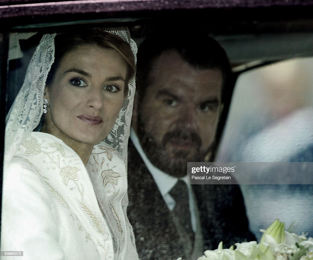 Letizia Ortiz and her father Jesus Ortiz arrive to Almudena cathedral moments before she marries Spanish Crown Prince Felipe de Bourbon May 22, 2004 in Madrid.