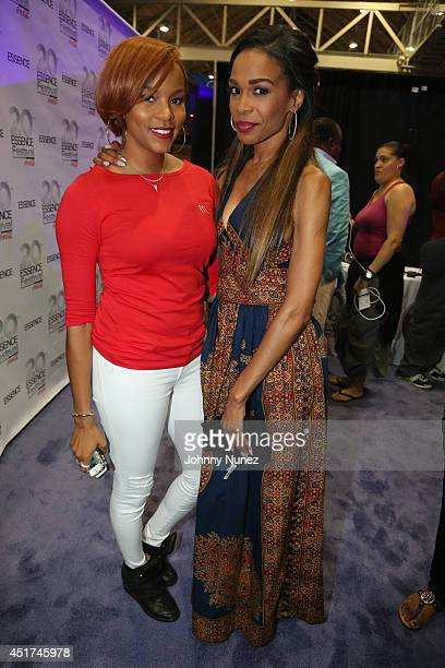 LeToya Luckett and Michelle Williams attend the 2014 Essence Music Festival on July 5 2014 in New Orleans Louisiana