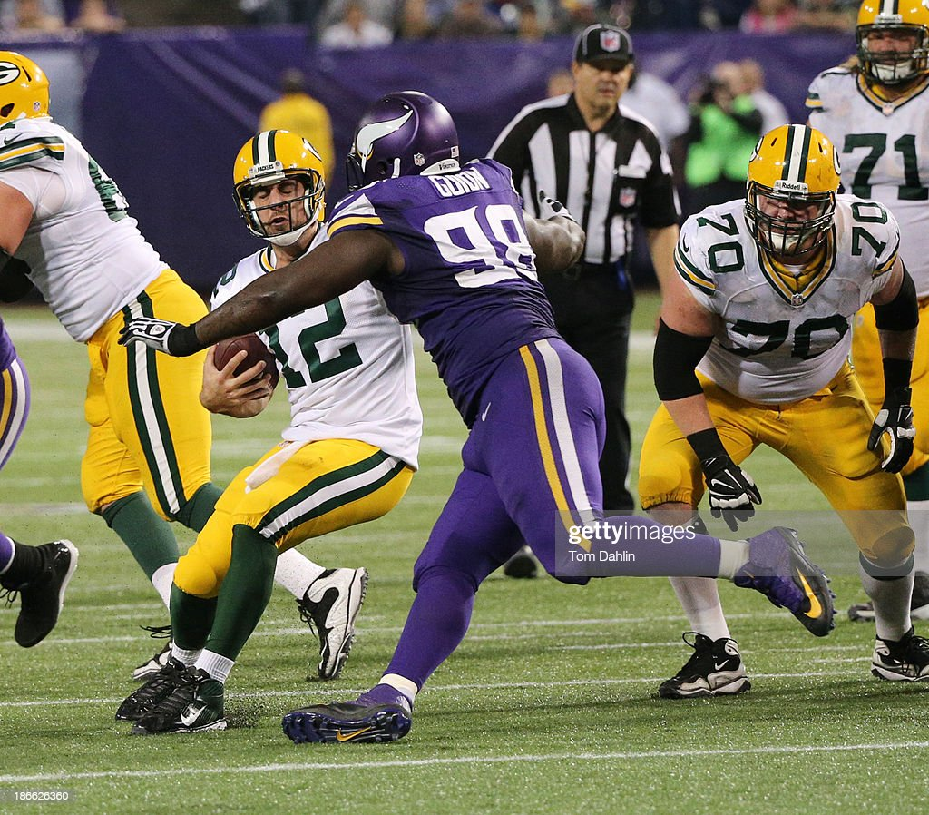 Letroy Guion #98 of the Minnesota Vikings sacks Aaron Rodgers #12 of the Green Bay Packers during an NFL game against the Green Bay Packers at Mall of America Field at the Hubert H. Humphrey Metrodome on October 27, 2013 in Minneapolis, Minnesota.