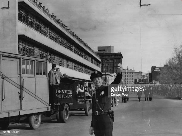 NOV 12 1951 'Let's Get Started' Officer E W Hammons waves units into line Monday morning as the big Armistice day Parade forms at civic center...