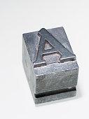 letter A metallic letterpress type block isolated on white