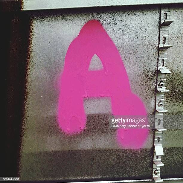 Letter A Written With Pink Paint On Wall