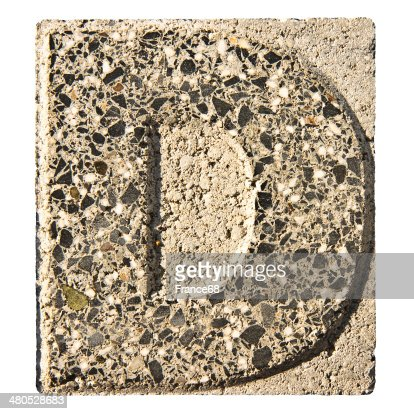 Letter D carved in a concrete block : Stock Photo