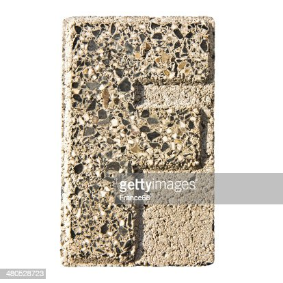 Letter F carved in a concrete block : Stockfoto