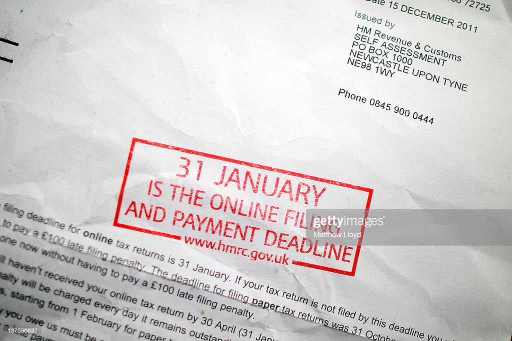 Tax return reminder letters photos and images getty images a letter from her majestys revenue and customs hmrc reminding of the date that ccuart Image collections