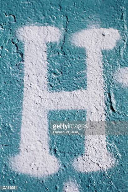 Letter 'H' painted on wall, close-up