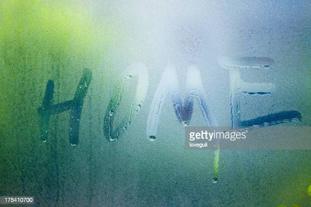 letter home write on grass with drop of water