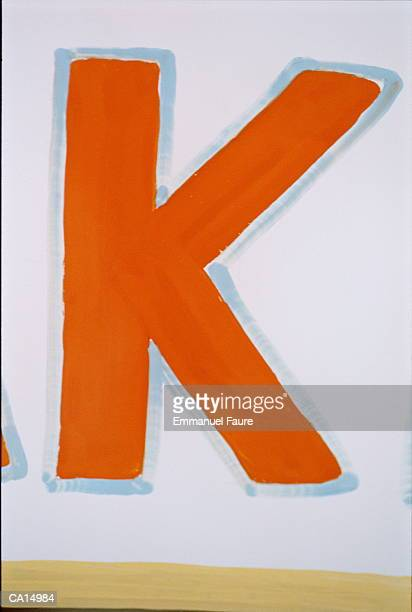 Letter 'K' painted on wall, close-up