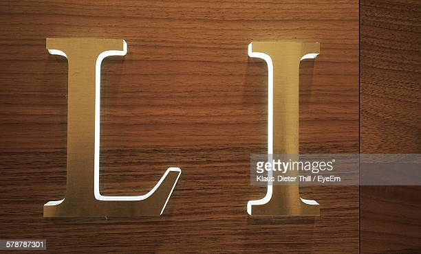 Letter L And I On Wooden Background