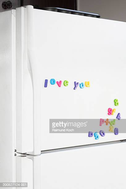 Letter magnets on fridge spelling out 'love you'