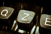 Z letter closeup between other letters on an original vintage typewriter's keyboard