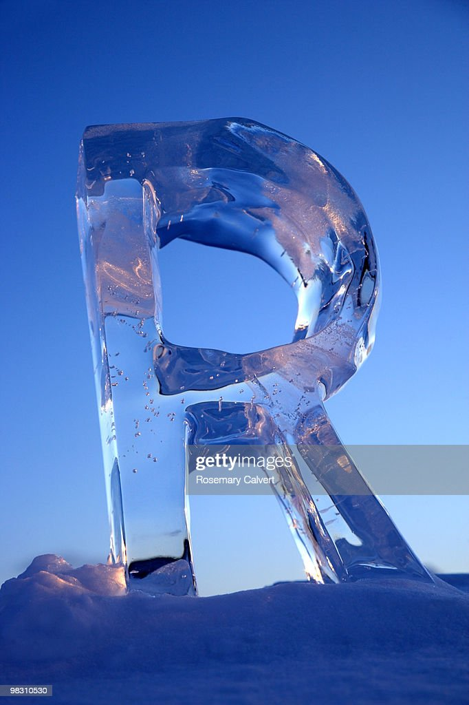 Letter R in ice at sunset, in the arctic.