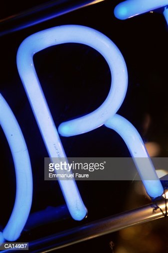 Letter 'R' on neon sign, close-up