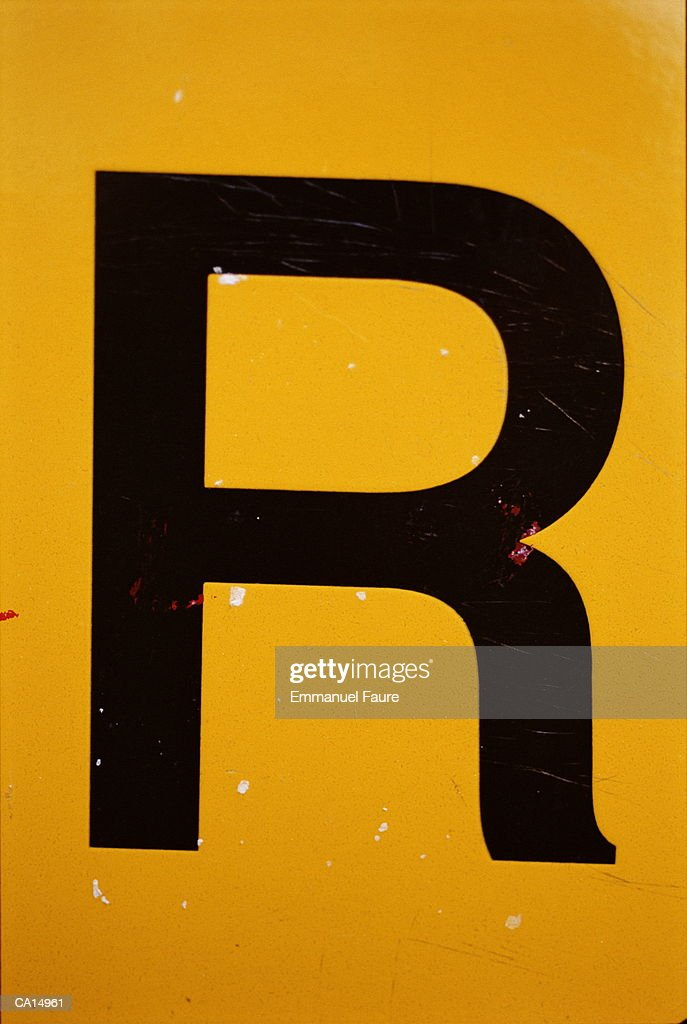 Letter 'R' painted on wall, close-up : Stock Photo