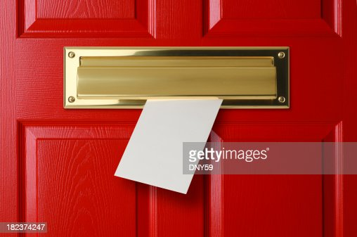 Letter Sliding Through Brass Mail Slot On A Red Door Stock