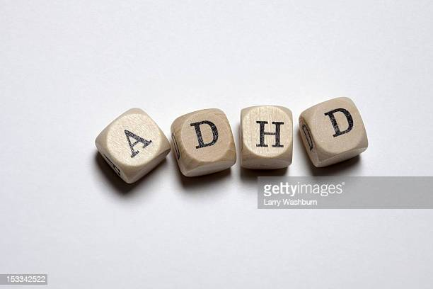 Lettered cubes arranged to spell the abbreviation ADHD