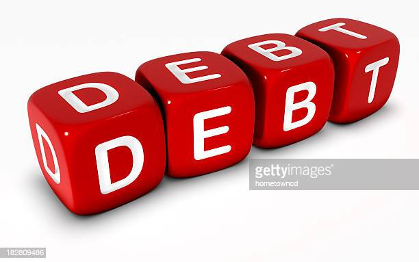 Lettered dice arranged to make the word DEBT
