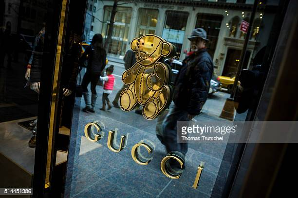 New York United States of America February 25 Lettering of the fashion brand Gucci at the door of a shop selling children's clothing in Manhattan on...