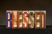 The word BLESSED spelled out with vintage letterpress wood block letters.