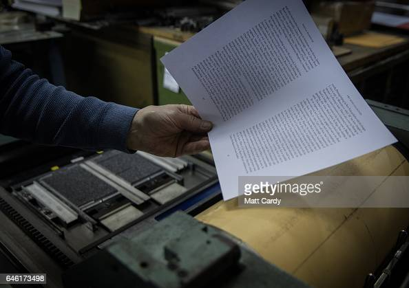 Letterpress printer Stan Lane looks at a page of text that has just been printed on a letterpress proof press at Gloucester Typesetting Services in...