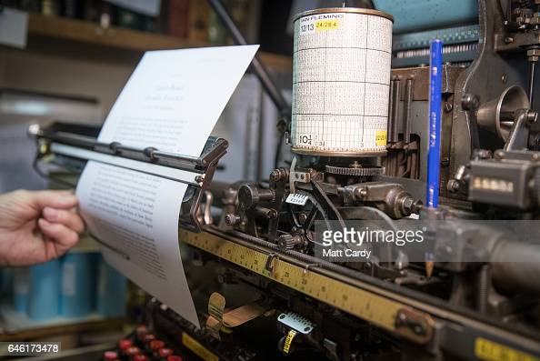 Letterpress printer Stan Lane who runs the last commercial Monotype business in Britain sits at a pneumatic Monotype keyboard as he works on a...
