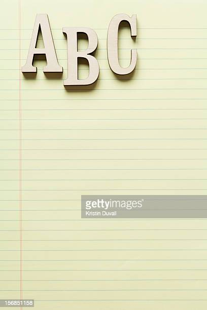 Letters A, B and C on yellow legal pad