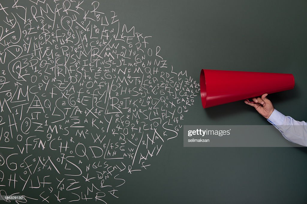 Letters And Numbers Coming Out From Red Megaphone On Blackboard