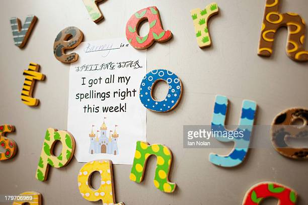 Letters and school certificate on wall