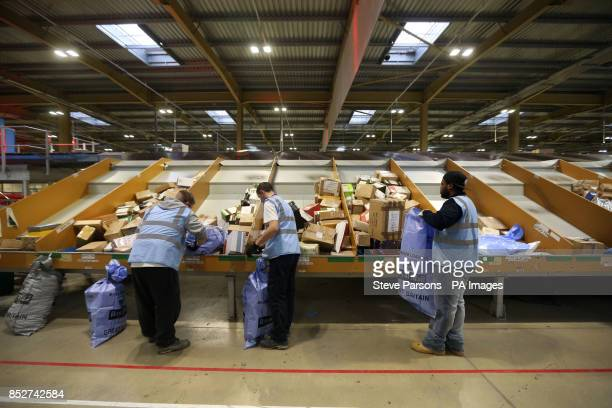 Letters Christmas cards and Christmas presents are sorted at the British Forces Post Office at RAF Northolt West London ahead of them being sent to...