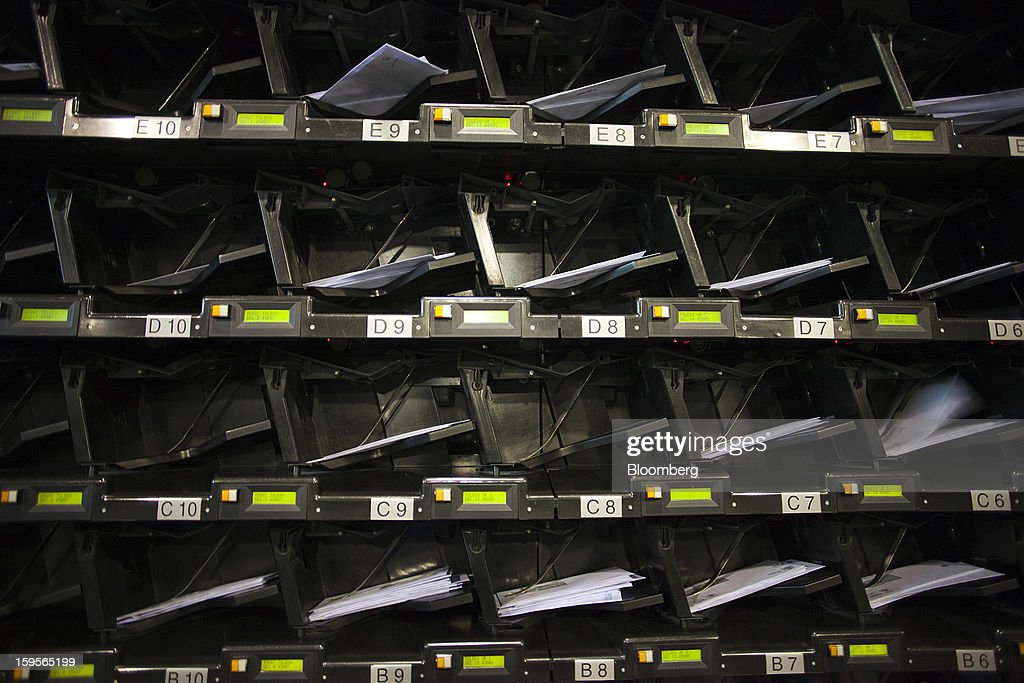 Letters sit in collection trays on an automatic sorting machine at the central sorting office of Sociedad Estatal Correos y Telegrafos SA, also known as Correos, in Madrid, Spain, on Tuesday, Jan. 15, 2013. Spain plans to privatize its state-owned postal company, Sociedad Estatal Correos y Telegrafos SA, Expansion reported citing Federico Ferrer, Vice Chairman of the state holding company. Photographer: Angel Navarrete/Bloomberg via Getty Images