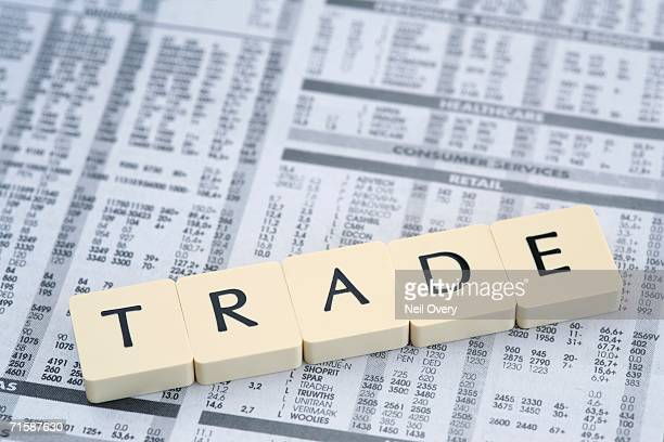 Letters Spelling Out 'Trade' On a Financial Paper